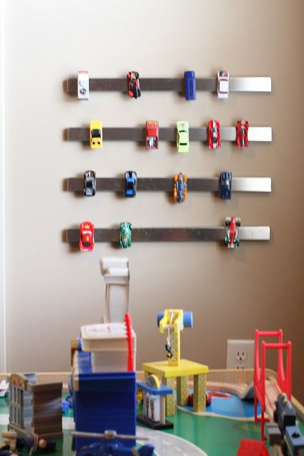 Easy DIY Hot Wheels Storage - Hang magnetic strips on the wall for a quick kid-friendly way to clean up Hot Wheels, Matchbox cars and other small metal toys!