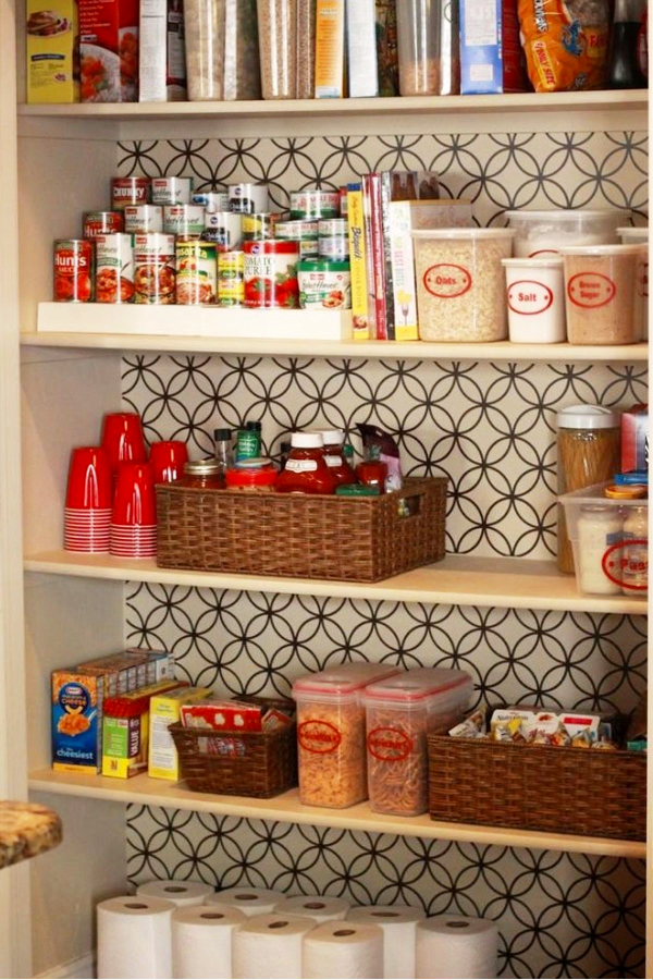 Put Wallpaper On The Back Wall Of Your Pantry and Use Labeled Baskets and Clear Canisters to Declutter Your Pantry Shelves - 30+ Kitchen Pantry Closets That Are Perfectly Organized